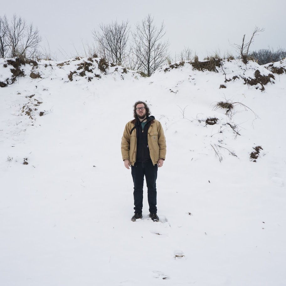 portrait of Jake Francis standing in the snow